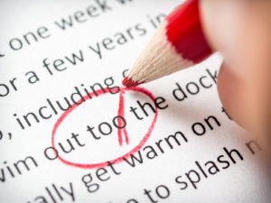 Editing essay with red pencil